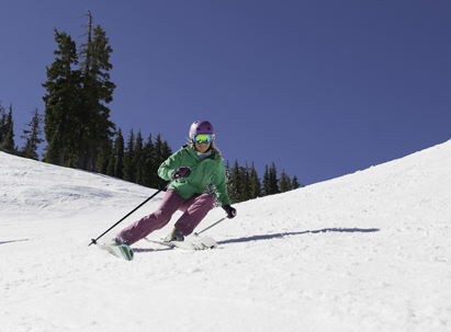 Ski Rental Rates - Skier making spring time turns