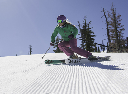 Responsibility Code Skier Turning on a groomer