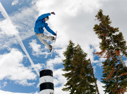 Terrain Park - Snowboarder doing a method over a bonk